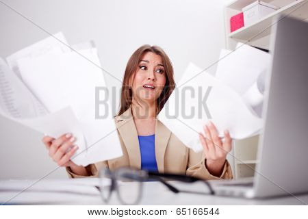 picture of worried woman with documents in office