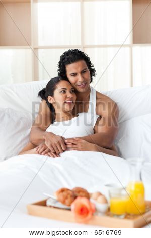Lovers Having Breakfast Lying On The Bed
