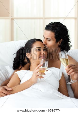 Man Kissing His Wife And Drinking Champagne