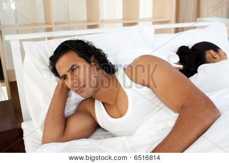 Upset Man In Bed Sleeping Separate Of A Woman