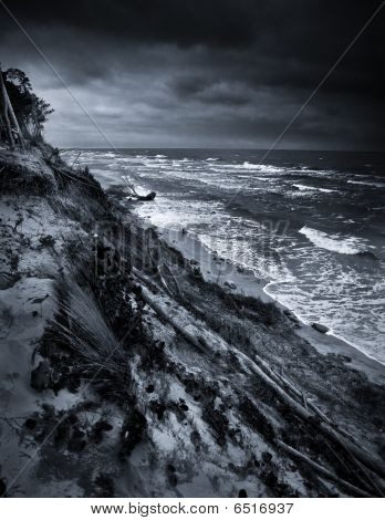 Baltic Coast With Eroded Beach And Landslide After Storm Dramatic Sky B/w