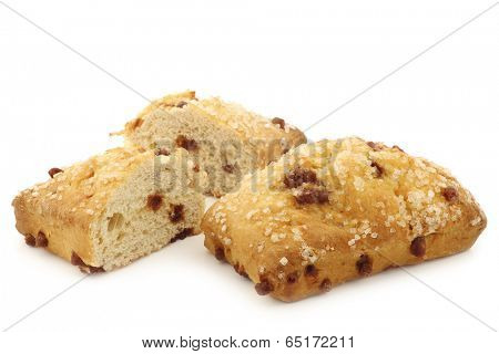Multigrain Quark Bread with chocolate chips and a cut one on a white background