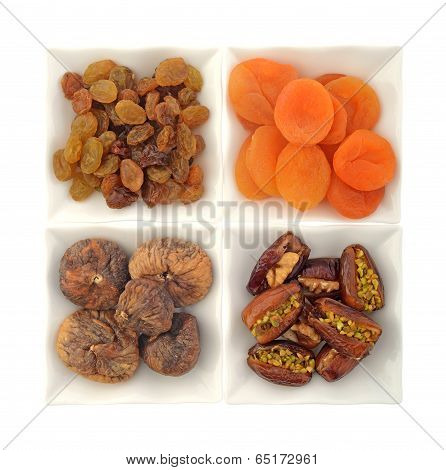 Dry fruit and nuts in white bowls