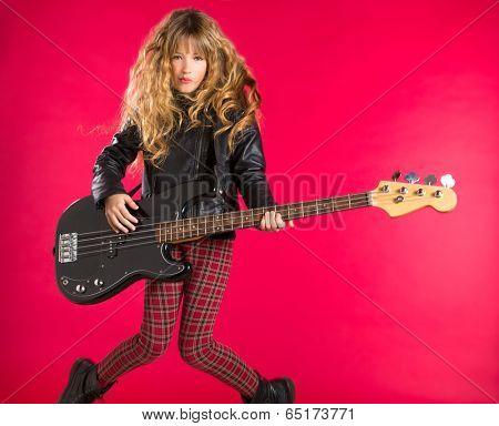 Blond Rock and roll girl playing bass guitar on red background