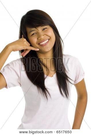 Young Beautiful Asian Woman Showing Call Sign