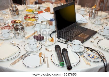 Laptop And Microphones On Restaurant Table