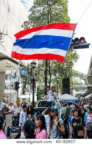 Bangkok - February 2: Unidentified Male Waving Thai Flag For Thailand's Protest Against The Governme