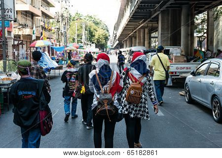 Bangkok - February 2: 2 Unidentified Muslim Women Walking To Thailand's Protest Against The Governme