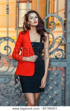 Girl In A Red Jacket With Scarlet Lips.