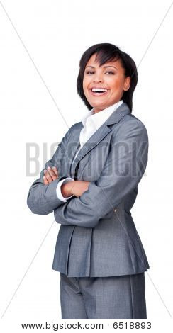 Businesswoman With Folded Arms Smiling At The Camera