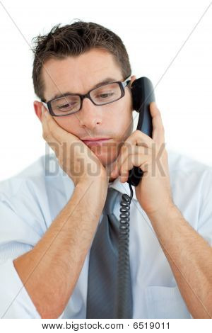 Young Businessman Sleeping On Phone