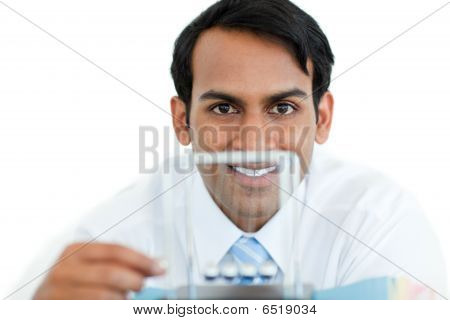 Smiling Businessman Playing With Kinetic Balls