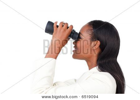 Portrait Of A Smiling Businesswoman Using Binoculars
