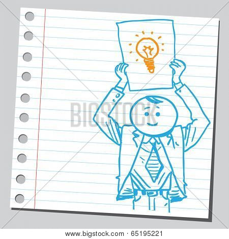 Businessman holding paper with light bulb drawing