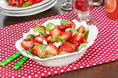 foto of antipasto  - Strawberry Spinach Salad and fruit juice with glasses on dining table - JPG