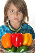 Little Boy With Colorful Peppers