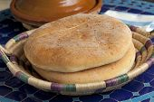picture of tagine  - Moroccan bread and tagine on the table - JPG