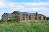 pic of derelict  - Derelict brick air field building in fields - JPG