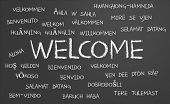 stock photo of hebrew  - Welcome word cloud written in many different languages on a chalkboard - JPG