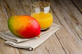 pic of mango  - Fresh mango juice and mango fruit on wooden table - JPG