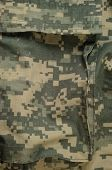foto of camo  - Universal camouflage pattern cargo storage pocket army combat uniform digital camo  macro closeup detailed large rip - JPG
