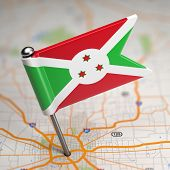 stock photo of burundi  - Small Flag Republic of Burundi on a Map Background with Selective Focus - JPG