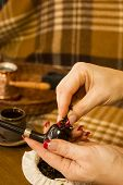 stock photo of tobacco-pipe  - Female hands laying tobacco smoking pipe - JPG