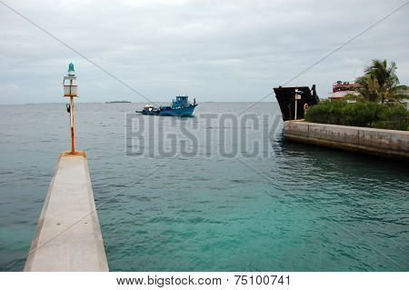 Blue Ship At Bandos Island Port Gate