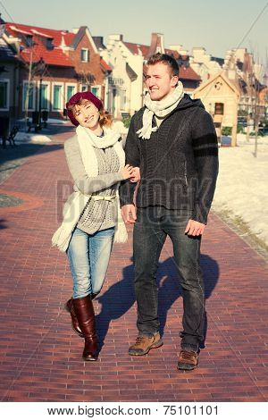 Young Couple Walking Around City In Winter.