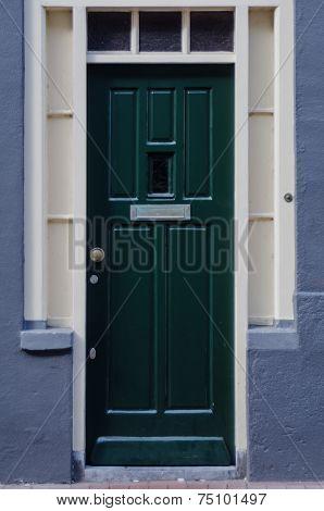 Dark Green Door On Blue Building