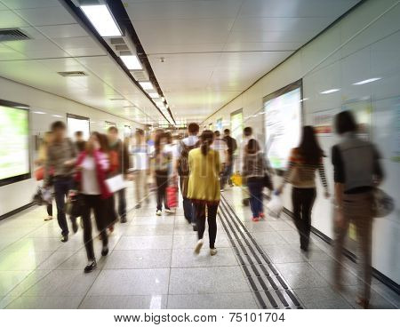 Passengers in a hurry to walk the modern subway station tunnels