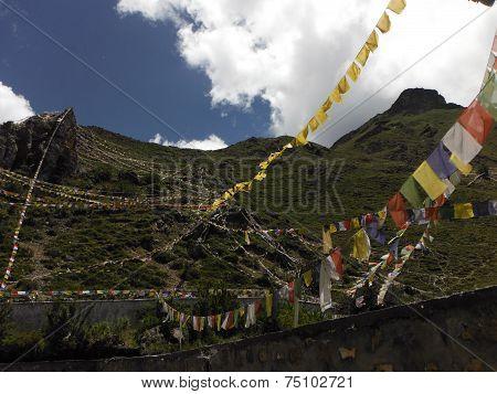 Prayer Flags On Mountains Surrounding Muktinath