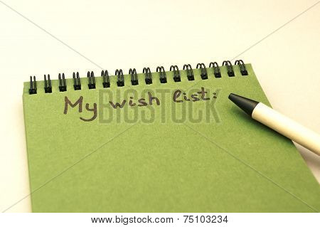 Hand Drawing Wish List On Green Notebook