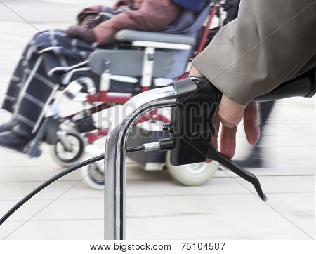 Man With Walking Frame And Wheelchair