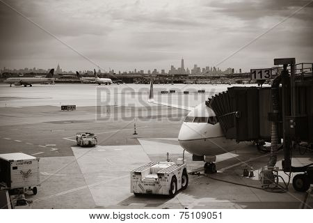 NEWARK, NJ - MAY 11: Airplane at airport with New York City skyline on May 11, 2014 in Newark, New Jersey. Newark airport is the 10th busiest in US.