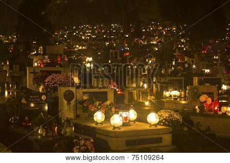 KRAKOW, POLAND - NOV 1, 2014: The evening before All Saints Day on Rakowicki Cemetery. Founded at beginning of the 19th century is one of the best known cemeteries of Poland.