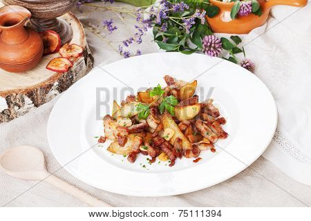 potato wedges with bacon on a plate