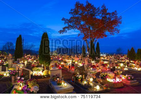 GORNA GRUPA, POLAND - NOV 1, 2014: Cemetary at night with colorful candles for All Saints Day in Poland. All Saints' Day is a solemnity celebrated on 1 November by the Catholic Church.