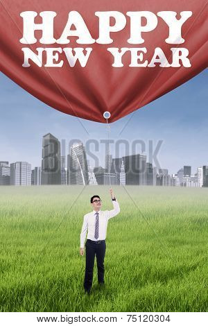 Male Worker Pulling New Year Text