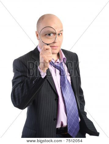 Businessman With A Magnifying