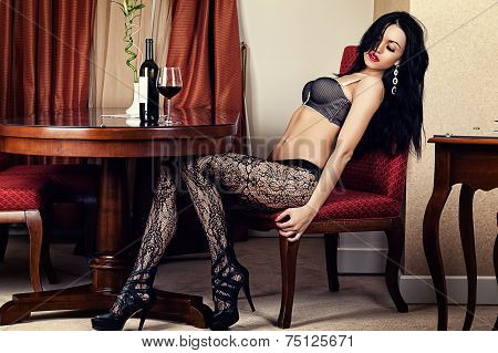 woman sitting in a chair in lingerie