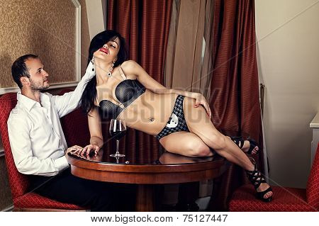 man caressing hand hair attractive woman