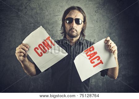 Man Tearing Apart Contract Document