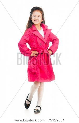 cute little girl in a pink raincoat isolated on white background