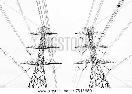 Black & White Abstract Hight Voltage Tower Line On The Sky Background.