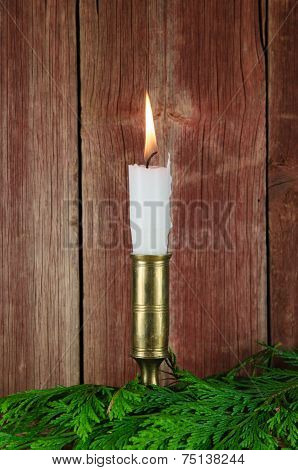 Single Candle At An Old Red Wall
