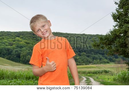 Cute blonde Boy In The Forest Shows All Ok.