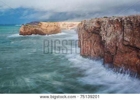Severe Dramatic Seascape Portugal. Fishermen In Sagres.