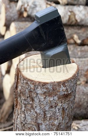 Axe  Prick To The Tree And Splitting It Into Two Parts.