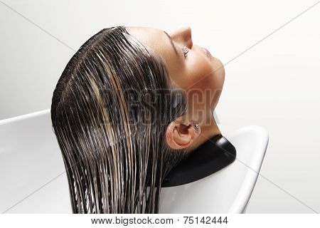 Woman's Head With Mask On Her Hair